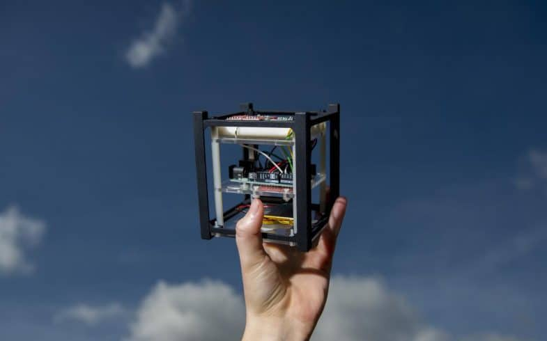 A model of the CubeSat satellite that is similar to the miniature satellite that University High students are building with other Irvine schools.    ///ADDITIONAL INFORMATION: satellite2.0317 Ð 3/14/16 Ð LEONARD ORTIZ, ORANGE COUNTY REGISTER - _DSC4991.NEF - Students at each of Irvine's high schools are teaming up to build and launch a miniature satellite, called a CubeSat, a year from now. Once in flight, the satellite's mission is to take pictures of the moon. The project is the brainchild of two Irvine dads, who have gotten the support of two scientists from NASA/JPL who are providing advice and assistance in their free time, local tech and communications firms, and $150,000 in seed money from Irvine Public Schools Foundation. Tinh Tran is the teacher leading the students from University High.