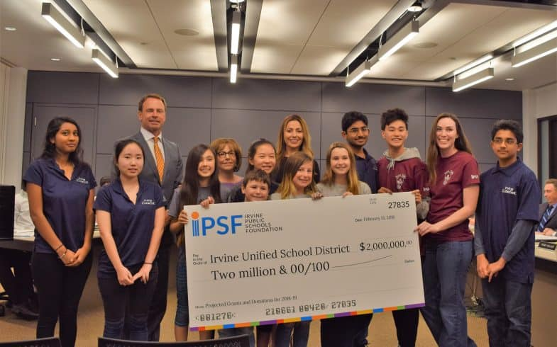 IPSF Presents IUSD with $2 Million Check